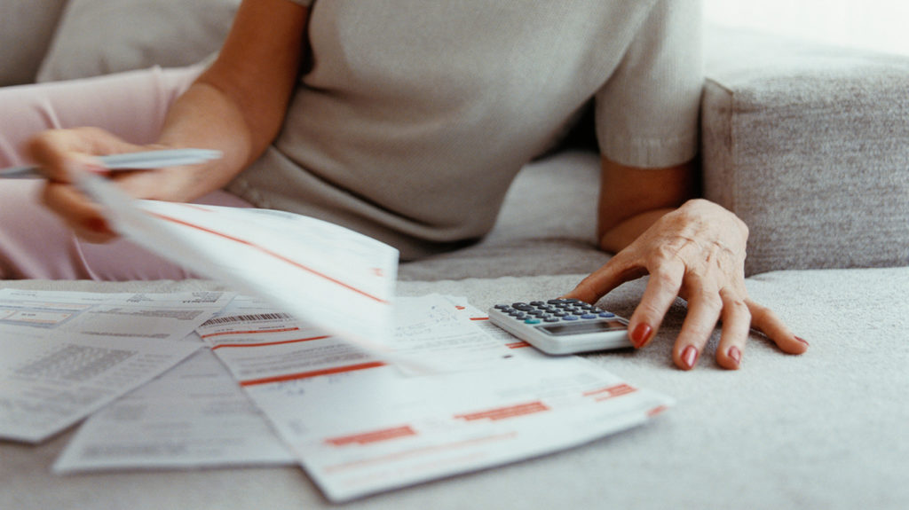 a woman looking through bills to see how much does medicare advantage cost per month