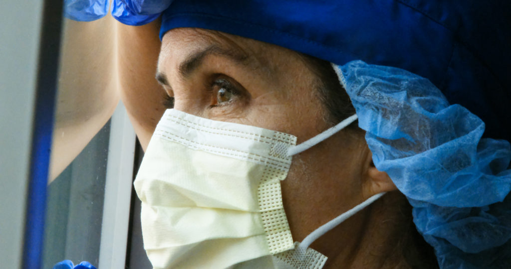 close up of female nurse looking out the window