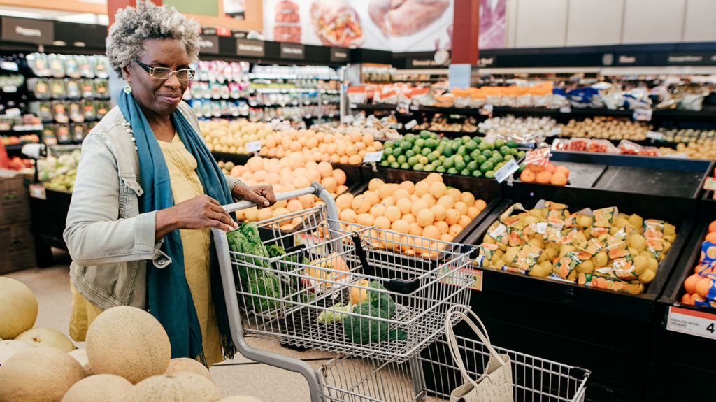 a senior woman food shopping for items that will help in a diet to manage symptoms of COPD