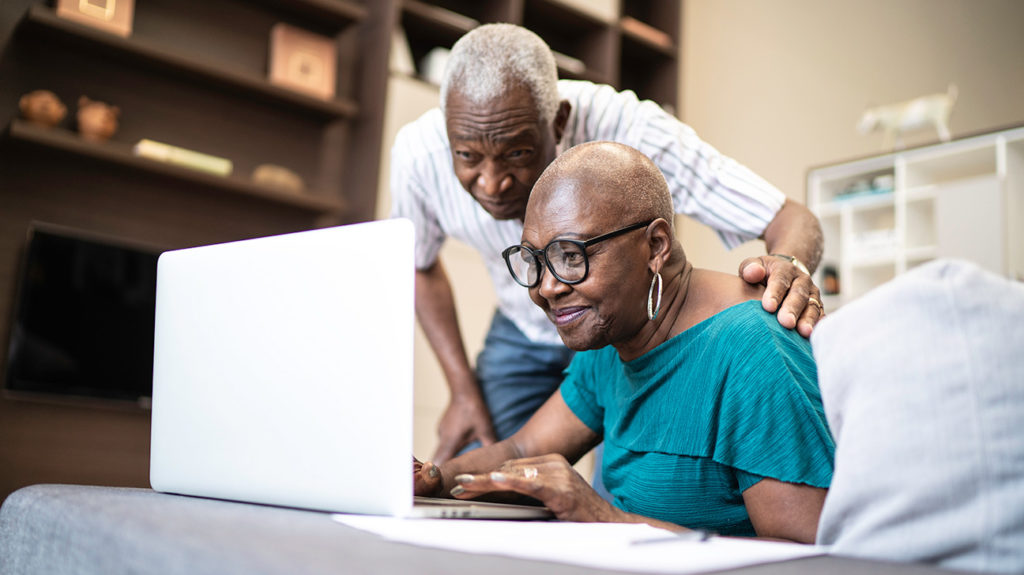 a senior couple looking at medicare supplement companies options on a laptop
