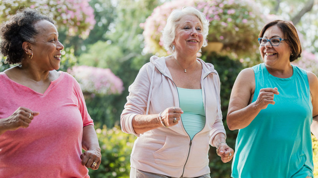 Three women, all part of the medicare diabetes prevention program, go on a walk around the neighborhood.