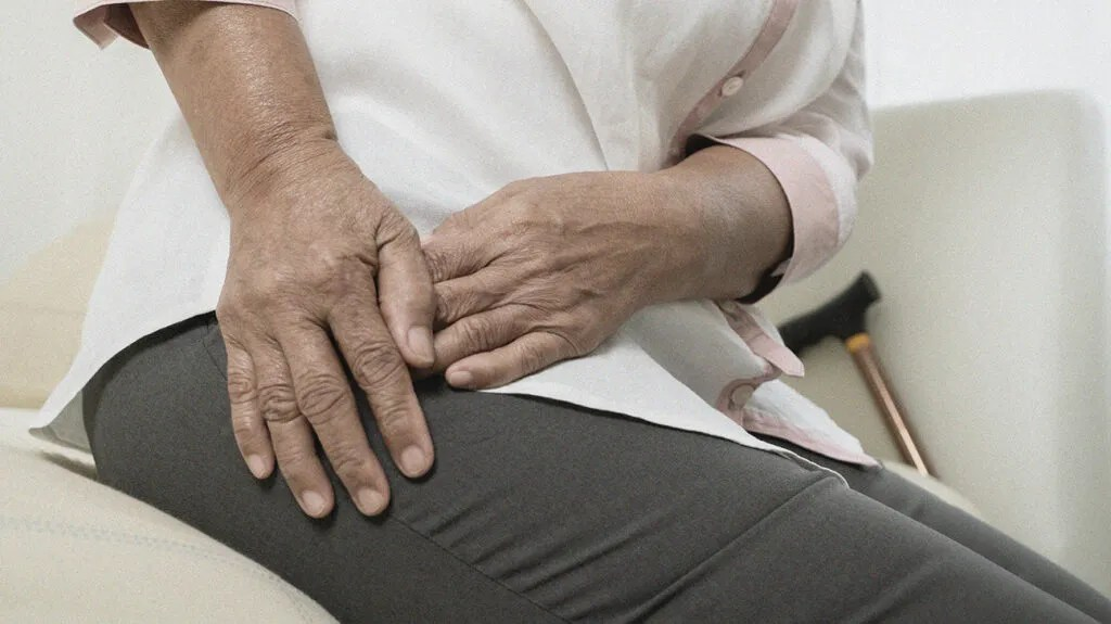 a woman holding her outer hip because she has pain there