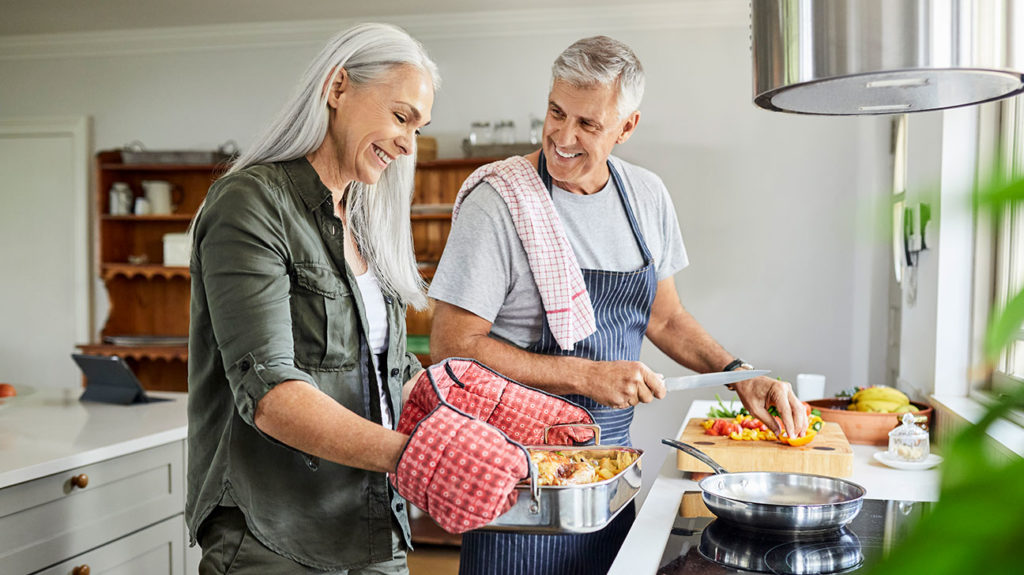 A man and his wife prepare dinner using foods that help manage erectile dysfunction.