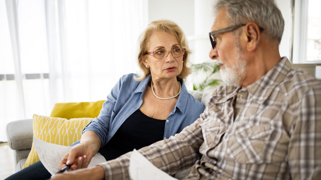 a senior couple looking at bills to do with medicare advantage msa
