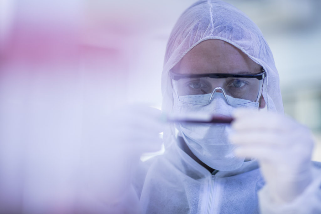 close up of scientist in PPE working with a blood sample