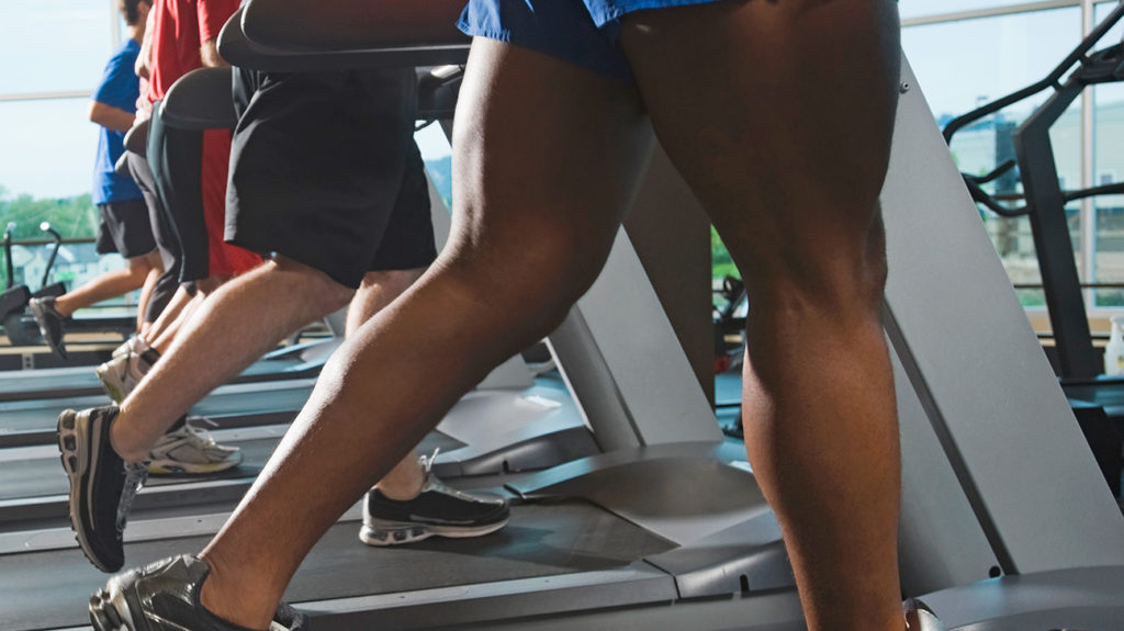 a row of people on treadmills which may cause sweating between their legs