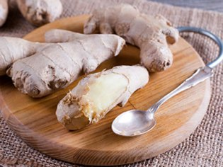 A photo of peeled ginger, which can be a food for helping an upset stomach.