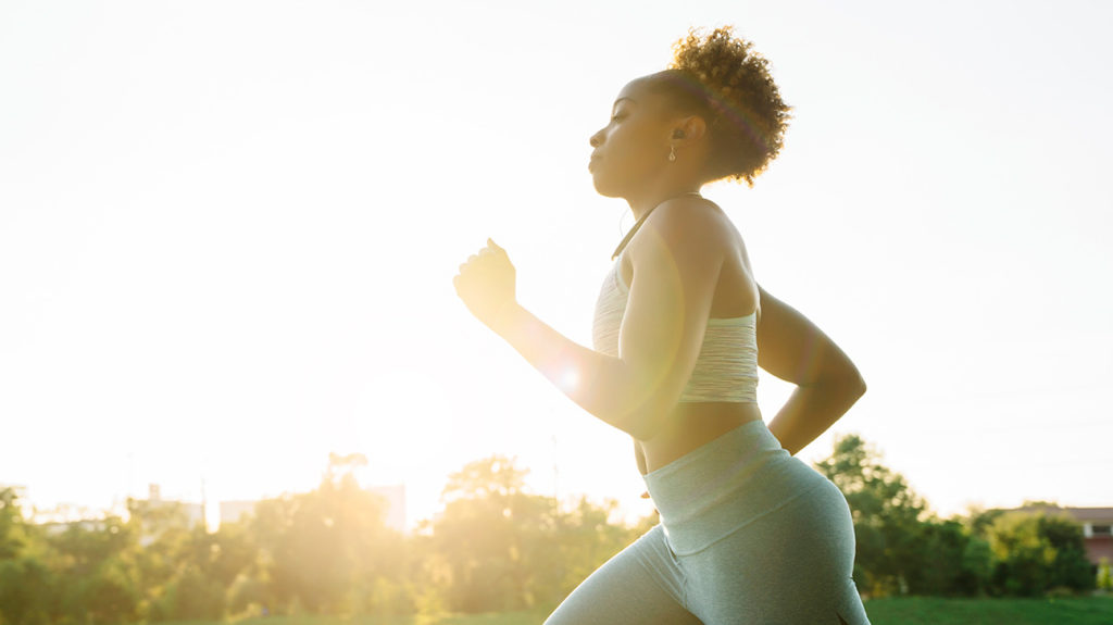 a woman running outside which may cause a Rash between the breasts