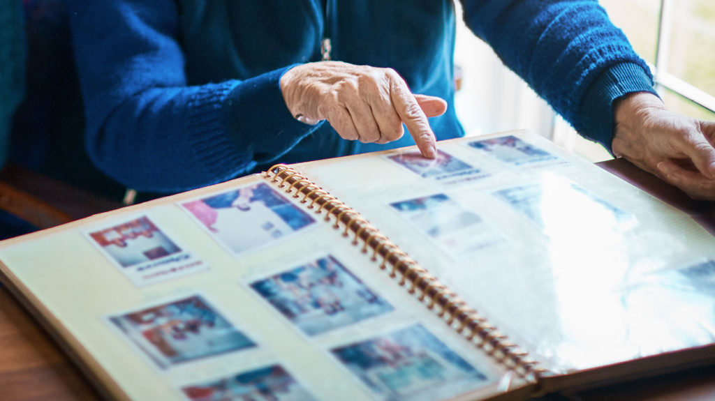 A woman with hyperthymesia looks through a photo album.