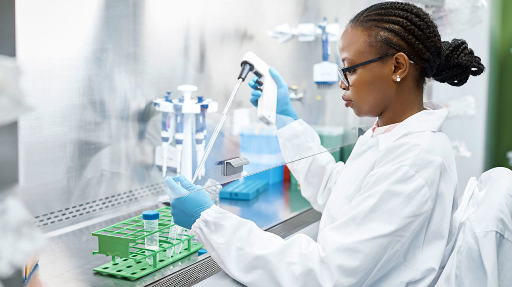A female scientist conducts research in a lab hoping to find a cure for HIV.