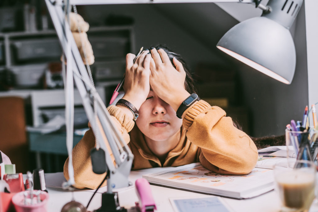 person looking stressed at their desk