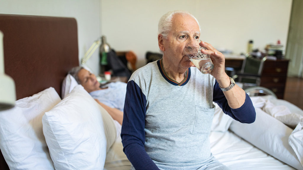 a senior man drinking water to counter balance a Electrolyte imbalance