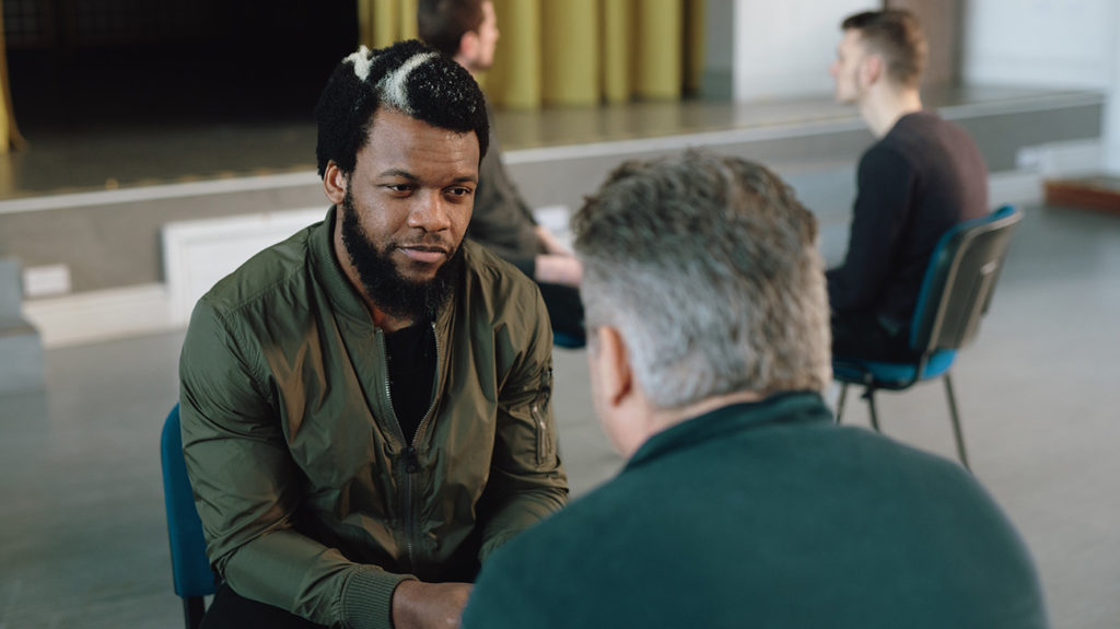 two men talking at a mens mental health group