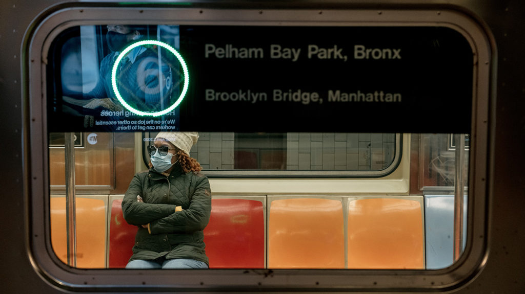 NEW YORK, NY - APRIL 17: A commuter wears a face mask while riding a subway train on April 17, 2020 in New York City. Following a new order from Governor Andrew Cuomo that New Yorkers must wear face coverings whenever social distancing is not possible, the measure is the latest in a series of communal steps taken to stop the spread of the deadly coronavirus (COVID-19). (Photo by Scott Heins/Getty Images)