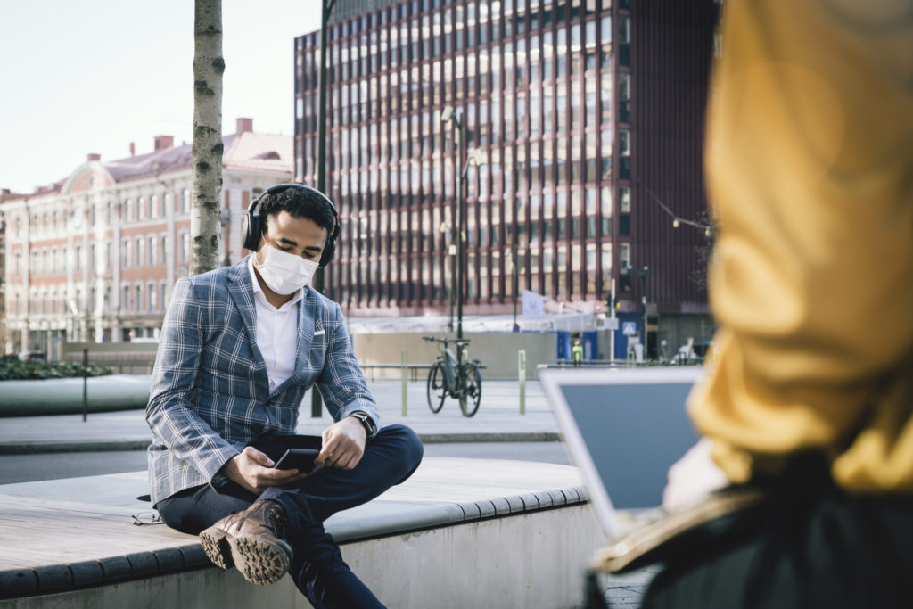 person in city center wearing face mask