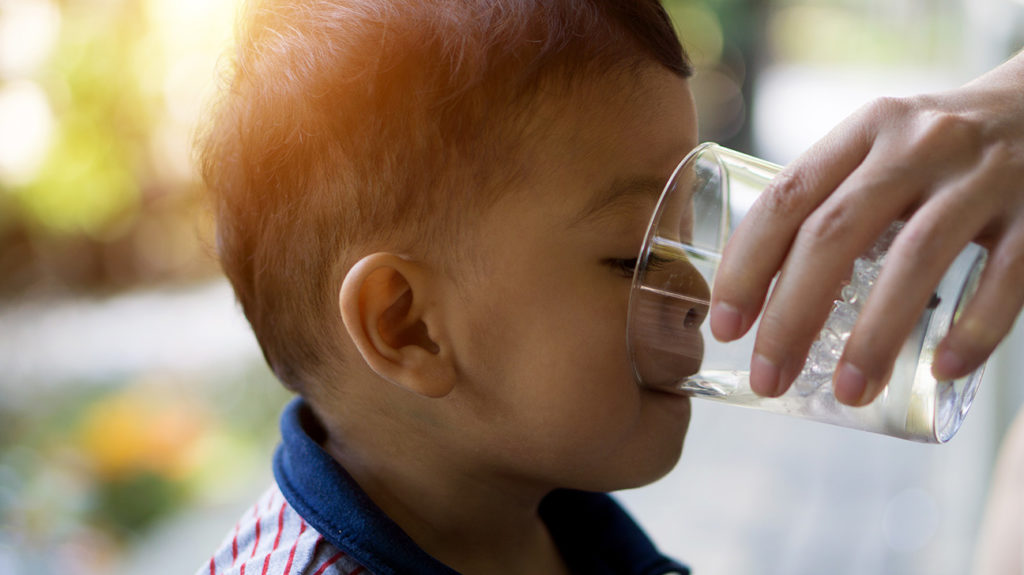 a child drinking water as a way to treat cyclic vomiting syndrome