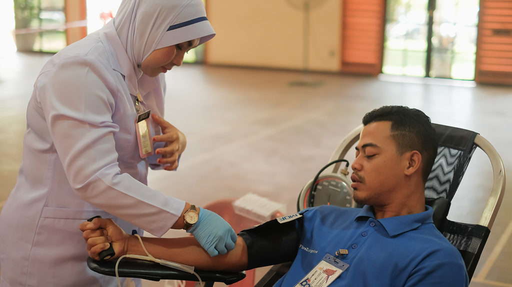 Muadzam Shah, Malaysia - February 21st, 2018 : Unidentified hospital staff holding blood pint donated by volunteer donor during blood donation campaign.