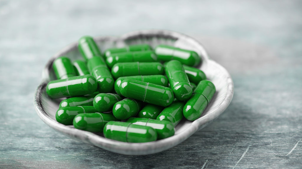 l carnitine pills in a bowl