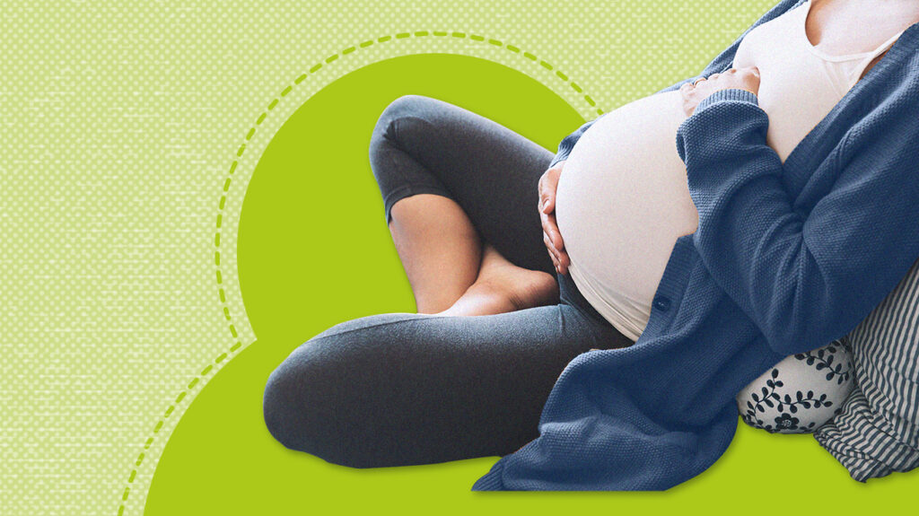 A woman uses one of the 7 best pillows for pregnancy
