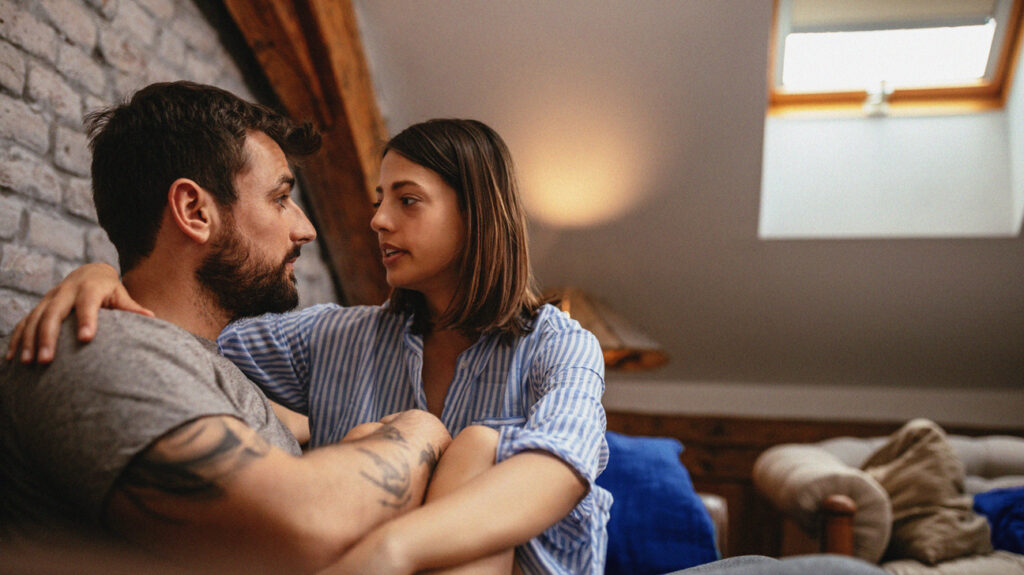 A man and a woman sat on a couch having a serious discussion about female arousal disorder.