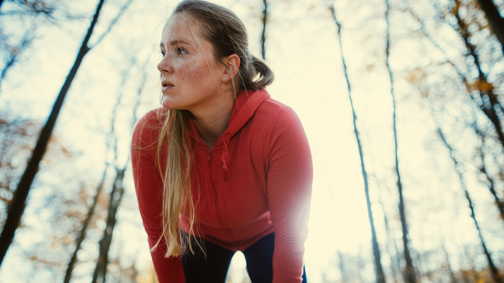 a woman out of breath while running because of High blood sugar limit
