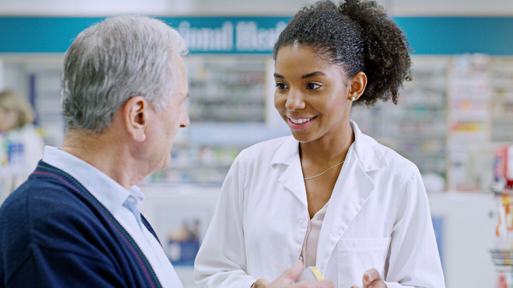 a man in a pharmacy talking to a doctor about whther does medicare cover suboxone