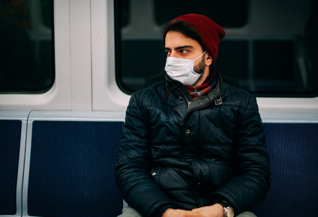 Man wearing face mask on a train