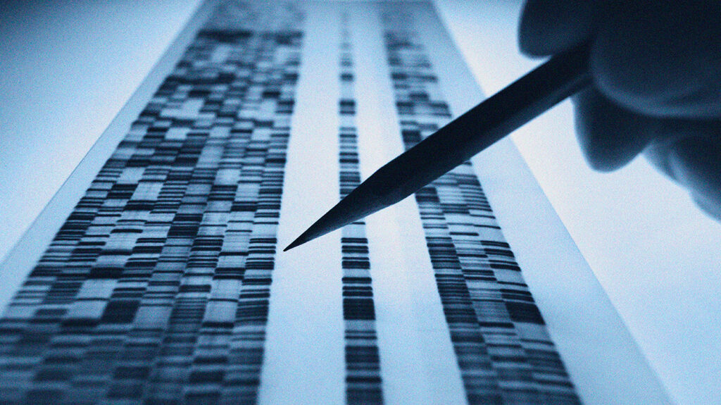 A close up of DNA sequencing taking place for genetic disorders.
