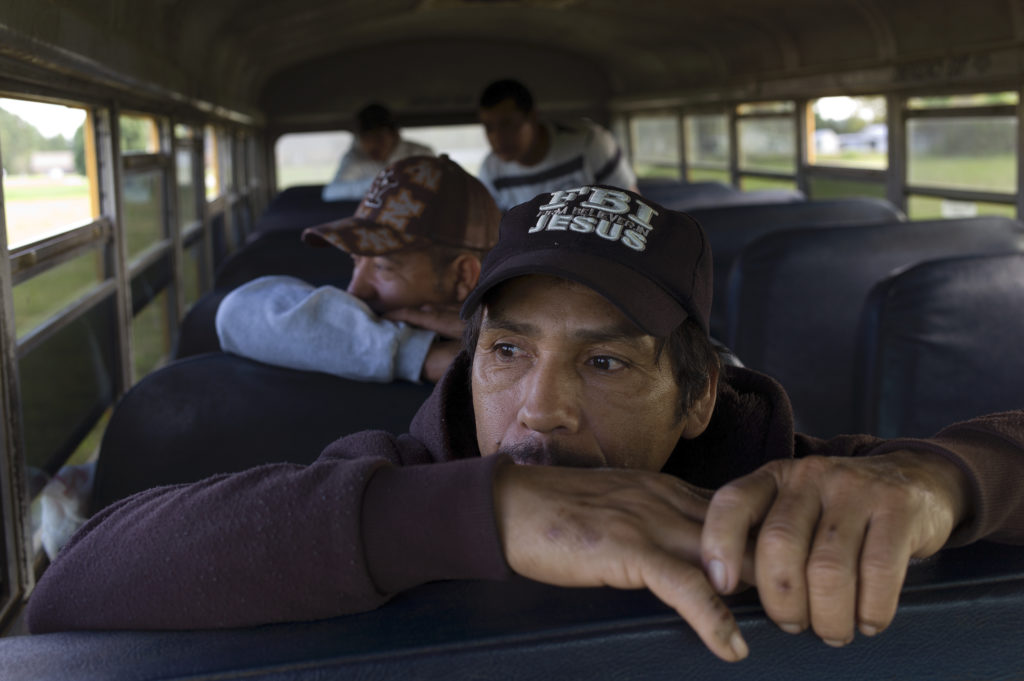 photo of migrants on a bus by Andrew Lichtenstein
