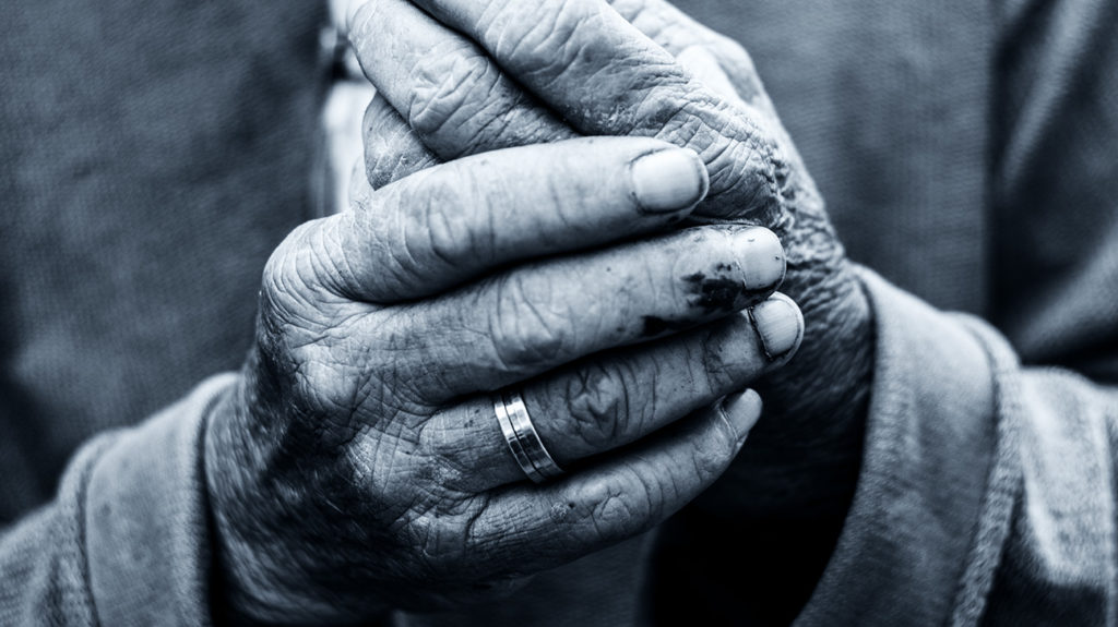 close up of the wrinkles on a man's hands