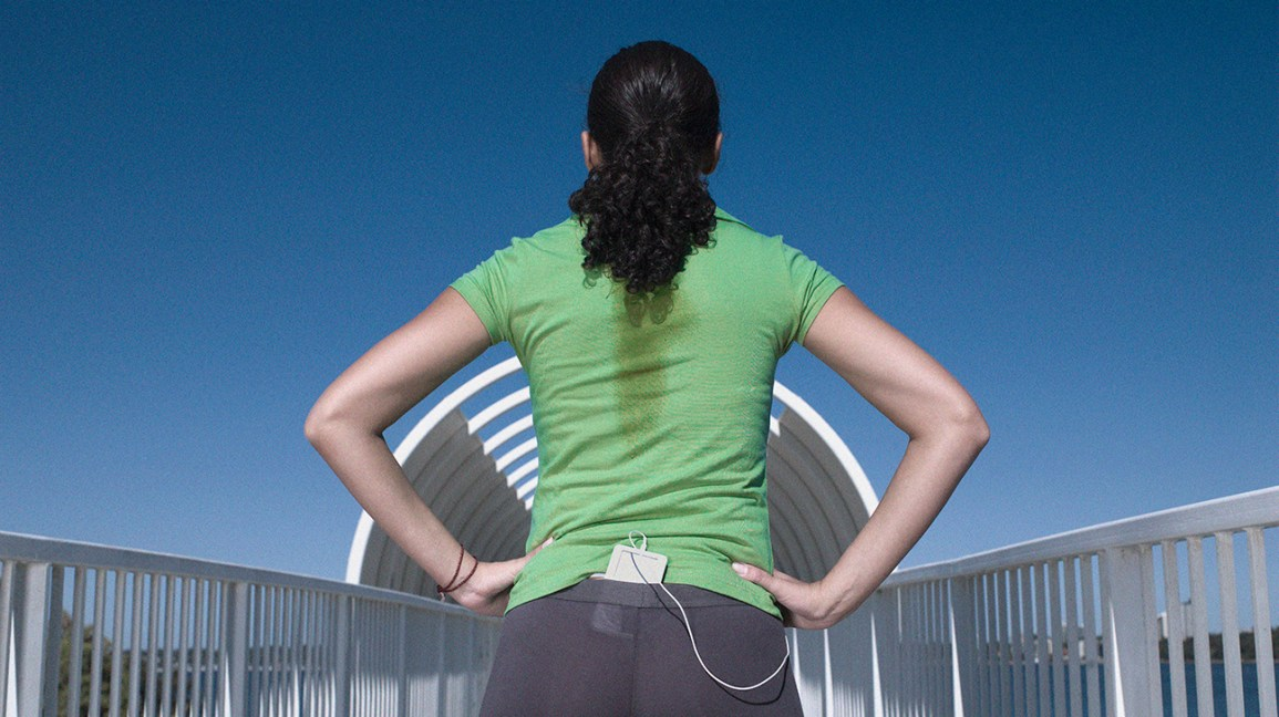 a female runner facing away from the camera with a Sweaty back