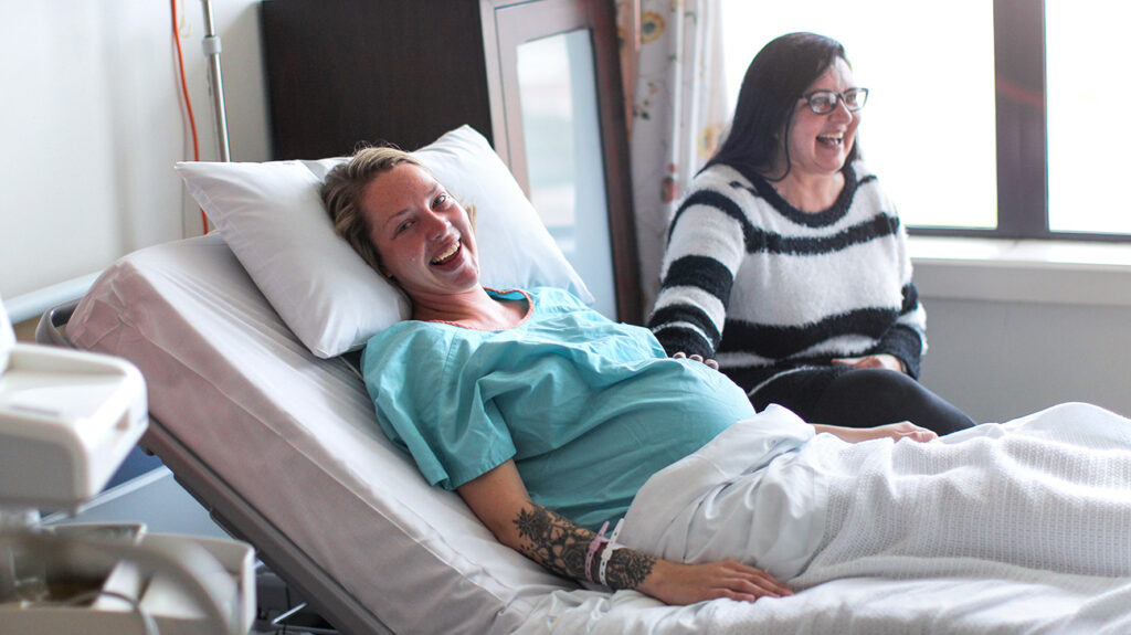 a pregnant woman in hospital as she is experiencing the early stages of labour