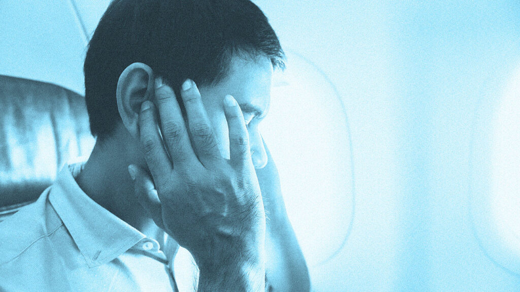 "A man thinks, ""My ears won't pop but I feel constant pressure,"" while on a plane."