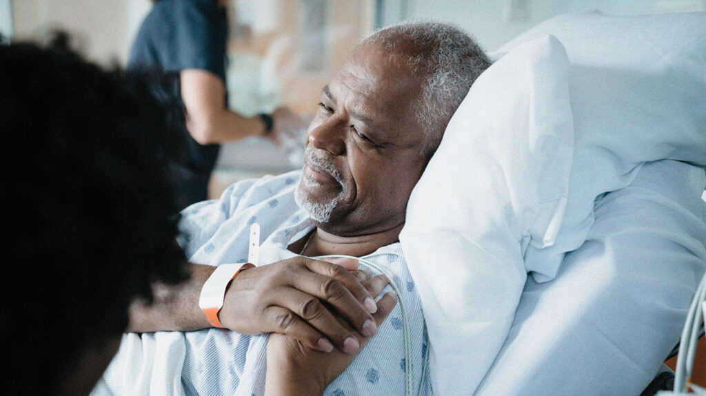 a senior man in a hopsital bed where the cost of his stay is covered by his medicare plan n plan