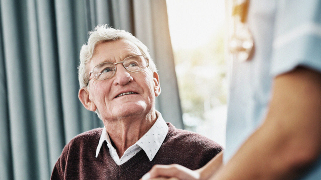 a senior man talking to a doctor about aarp medicare supplement