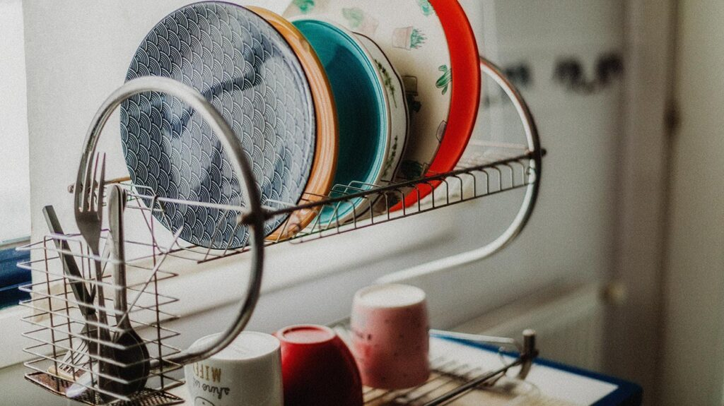 "An image of dishes drying in the dish rack to accompany the article, ""People with eating disorders negatively affected by lockdown"""