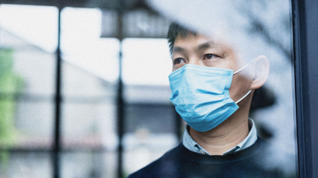 A man in Wuhan, China, looks out his window in an image to accompany an article about how the average incubation period for COVID-19 may be longer than a week, according to new data from more than 1,000 people who contracted the new coronavirus in Wuhan, China.