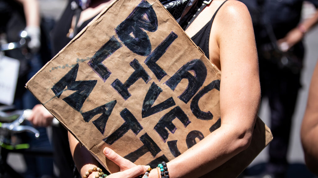 A white woman holds a Black Lives Matter sign at a protest in New York on June 12, 2020, USA. (Photo by Ira L. Black/Corbis via Getty Images)
