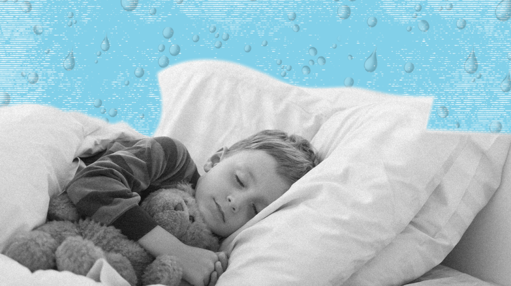 A child is sleeping on top of one of the best waterproof mattress protectors.