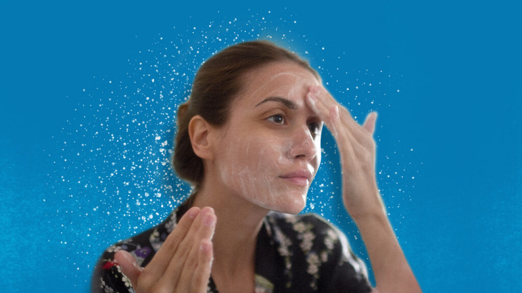 A person using some of the best face wash for oily skin.