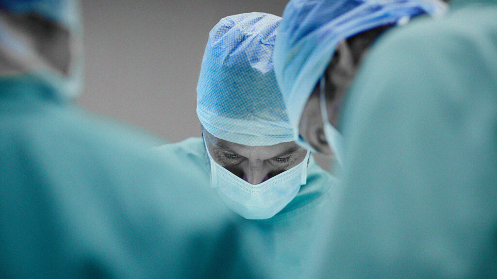 Doctors performing an adult circumcision procedure.
