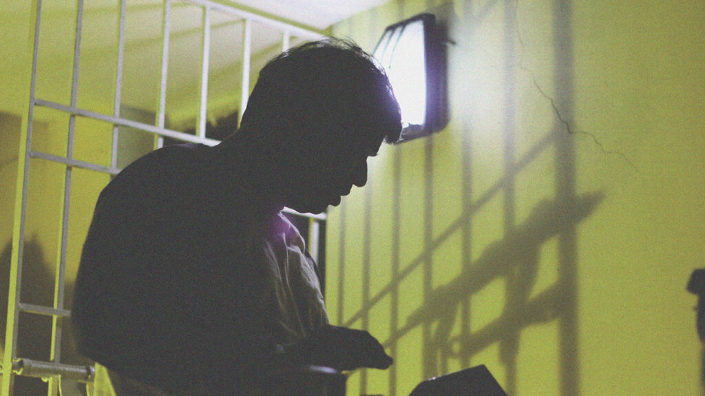 silhouette of a man incarnated in prison