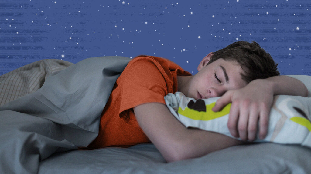 Child asleep on bed after taking melatonin supplements.