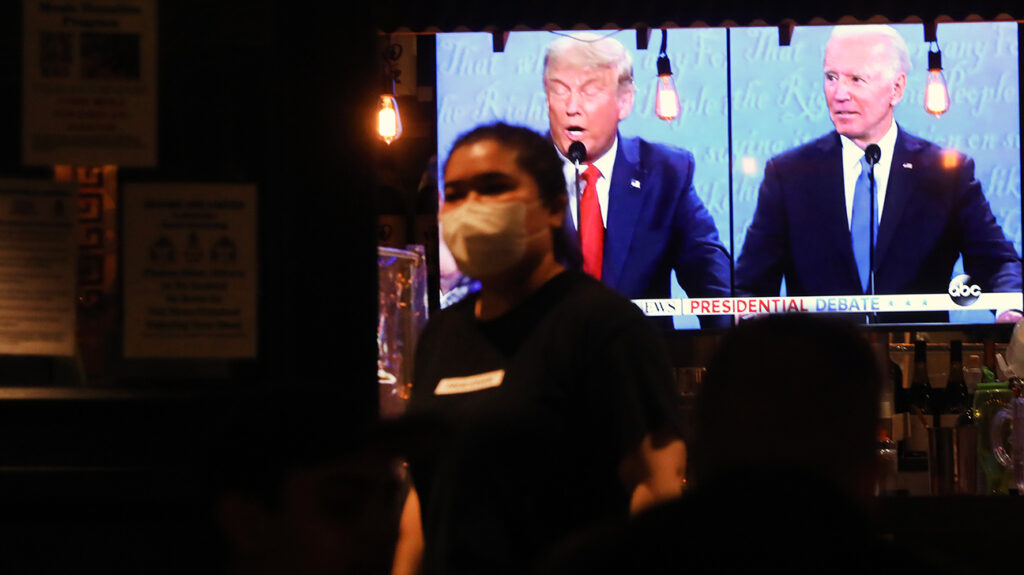 Presidential debate displayed on television in a bar