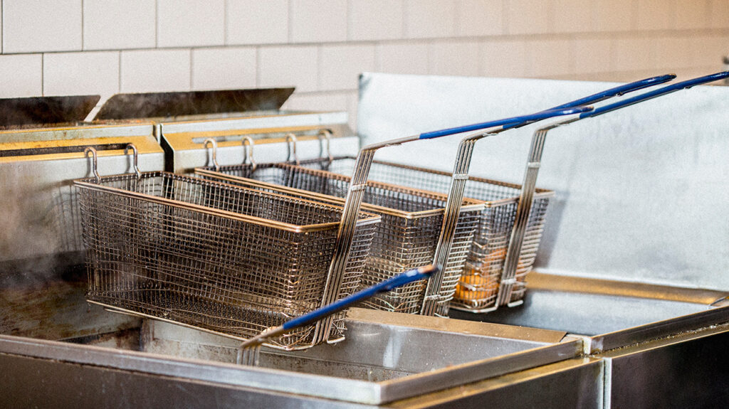 Chip fryers in fast food outlet kitchen