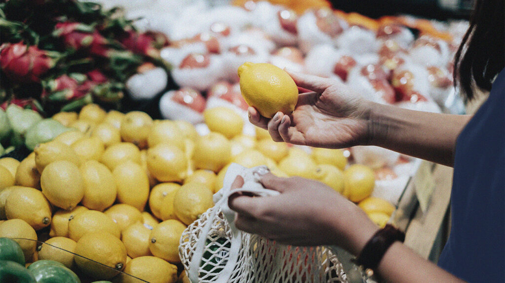 a person shopping for lemons
