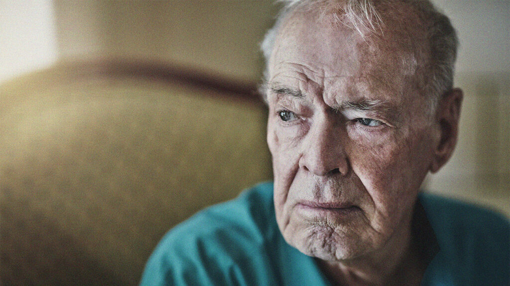 Close-up of an older male adult with an expression of sadness on his face, wondering does Medicare cover grief counseling