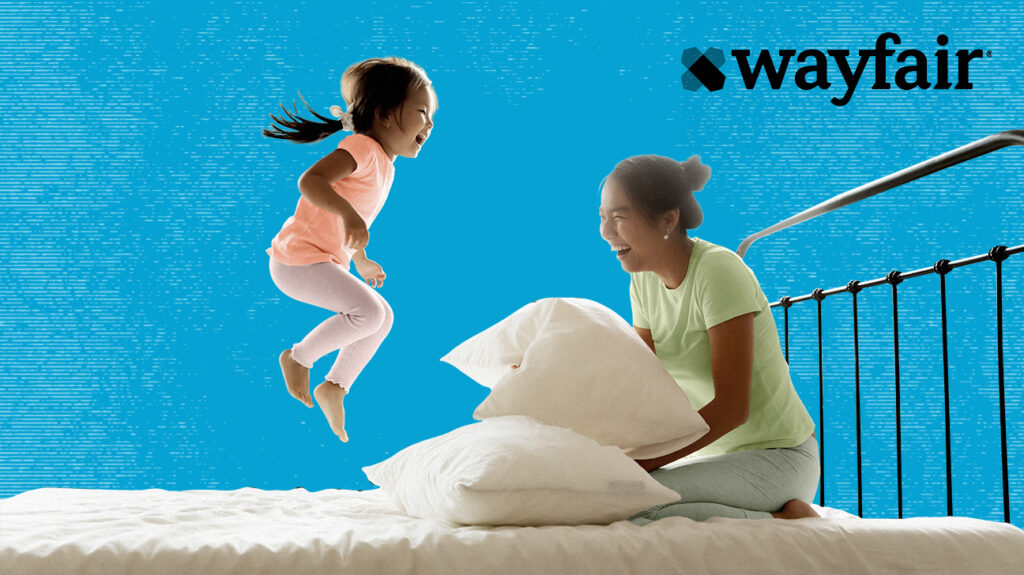 A child and caregiver jumping on a Wayfair mattress.
