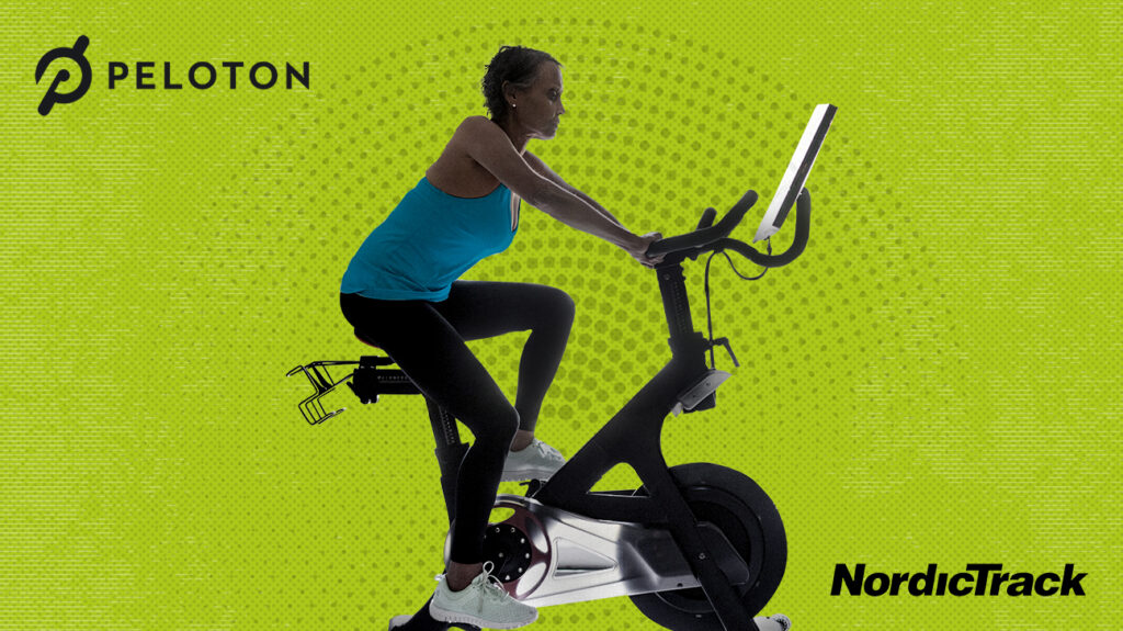 A person using an interactive indoor bicycle to exercise.