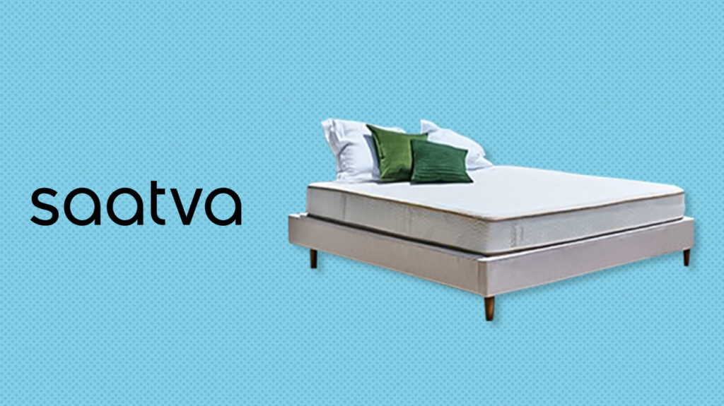 Saatva mattress on a bed with logo over blue background